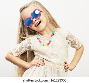 Fashion portrait of girl child. Sunglasses.