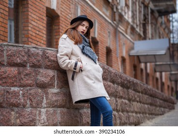 Fashion portrait of glamour sexy romantic lady wearing casual coat, black hat. Cold spring autumn season.