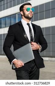 Fashion portrait of an handsome businessman in an urban setting