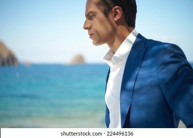 Fashion portrait of a handsome man in blue suit