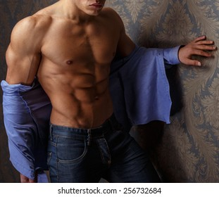 Fashion portrait of man body in blue shirt.