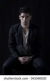 Fashion portrait of a man sitting