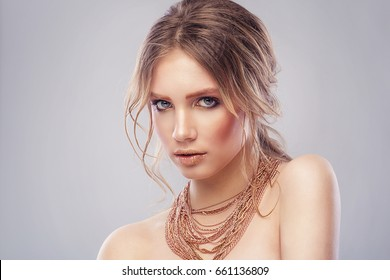 Fashion portrait model girl, with a many golden chains