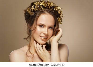 Fashion portrait model girl, on a beige background