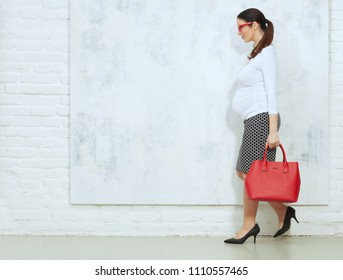 Fashion portrait of pregnant businesswoman - pregnant woman in business casual.