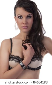 fashion portrait of pretty and sexy girl in light lingerie with long hair and jewellery
