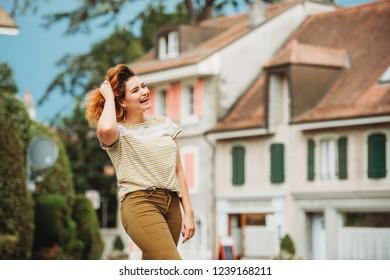 Fashion portrait of pretty young woman posing ouside, plus size model