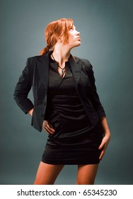 fashion portrait of a red hair sexy woman, studio shot
