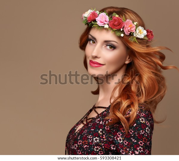 Fashion Portrait Redhead Beautiful Young Woman with make up in Stylish Floral Dress, colorful Hairband. Pretty Sensual Lady. Trendy fashionable Outfit, Wavy Curly Hairstyle, Makeup