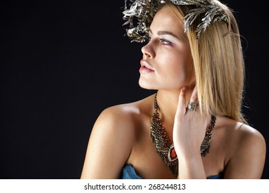 Fashion portrait of sensual blond female with hair style, isolated on dark background