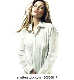 Fashion portrait of sensual blond in man's shirt