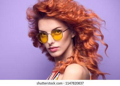 703be3a7829c Fashion Portrait Sensual Redhead Girl with Trendy Wavy Curly Hairstyle in  Studio. Beautiful woman in