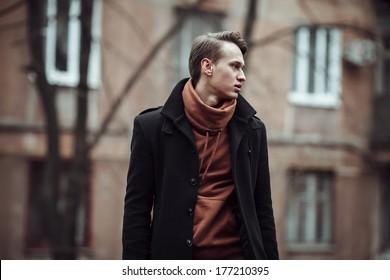 fashion portrait of a stylish man posing outside, autumn time