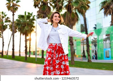 Fashion portrait of stylish woman posing at Barcelona street, palms around, neon sunglasses, traveling mood, casual hipster outfit, joy, free spirit.
