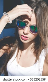 Fashion portrait of stylish woman in sunglasses.Outdoor fashion image of stylish young lady,fashionable.Lifestyle portrait of stunning hipster girl.Toned.