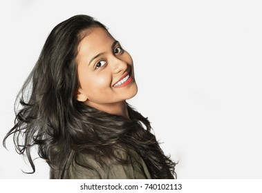 Fashion portrait of stylish young indian girl on a white background