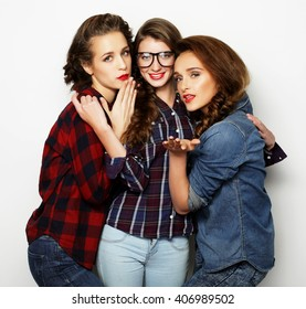 Fashion portrait of three stylish sexy girls best friends