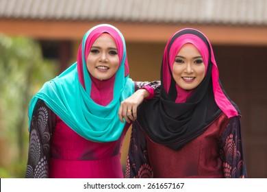 Fashion portrait of two young beautiful muslim woman wearing hijab