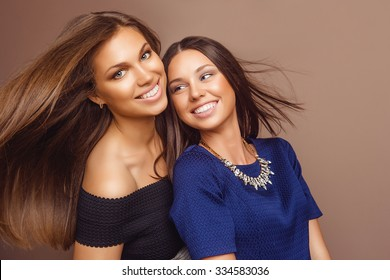 Fashion Portrait of Two Young Beautiful Women Girls in in Bright Colorful Cloth. Friendship.