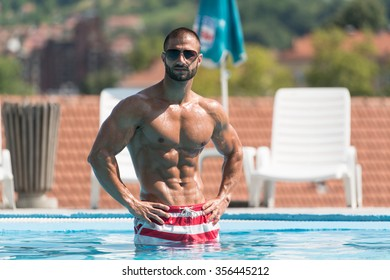 a3b0af25bd Fashion Portrait Of A Very Muscular Sexy Man In Underwear At Swimming Pool