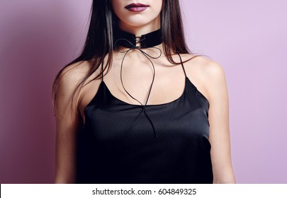 Fashion portrait woman with black velvet choker lace up. Necklace gothic accessory