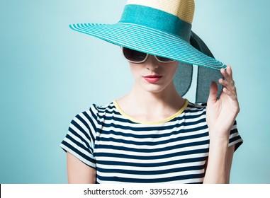Fashion portrait of woman wearing hat