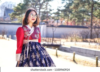 Fashion Portrait of young Asian Beauty girl in Hanbok traditional Korean clothes in autumn winter at the Gyeongbokgung Palace, Seoul, South Korea