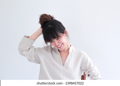 Fashion Portrait of Young  asian woman wearing natural fabric linen minimal clothing - copy space white background