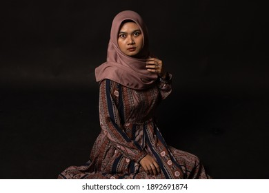 Fashion portrait of young beautiful asian muslim woman with wearing hijab isolated on black background