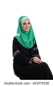 Fashion portrait of young beautiful asian muslim woman with wearing hijab smile while standing against white background. Selective focus.