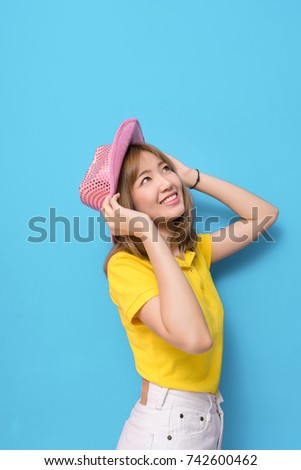 41f23a8f8af Fashion portrait of young beautiful asian girl with relax dress yellow shirt  and white jeans pants