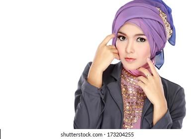 Fashion portrait of young beautiful muslim woman with purple costume wearing hijab