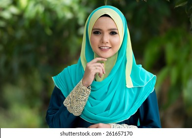 Fashion portrait of young beautiful muslim woman wearing hijab