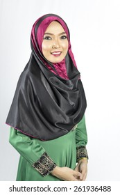 Fashion portrait of young beautiful muslim woman wearing hijab