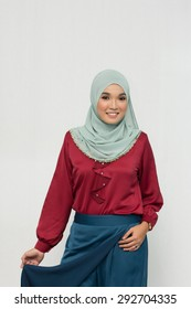 Fashion portrait of young beautiful muslim Asian woman wearing hijab