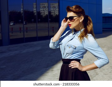 Fashion portrait of young beautiful and sexy brunette girl in trendy casual clothes. Vogue style. Outdoor shot. Street fashion concept