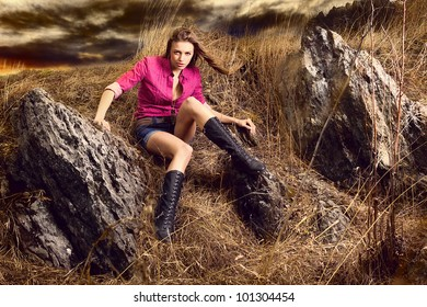 Fashion portrait of young beautiful woman in nature looking in camera her hair are streaming
