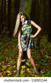 Fashion portrait of young beautiful woman  posing in nature