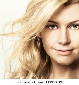 Fashion portrait of young beautiful woman  posing in studio