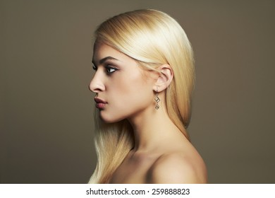 fashion portrait of Young blond woman.Beautiful Girl with healthy hair