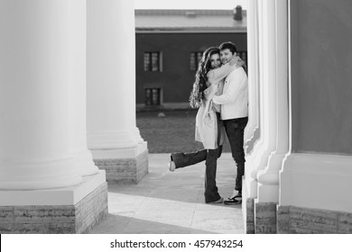 Fashion portrait of young couple in love posing at street. Beautiful girl and handsome boy hugging outdoors