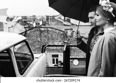 fashion portrait of young couple under the umbrella