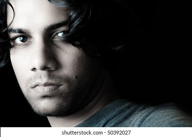 Fashion portrait of young man from India
