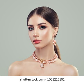 Fashion Portrait of Young Woman with Makeup and Pink Agate Necklace and Earrings