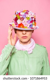 Fashion portrait of a young woman woman wearing stylish accessories. Hidden eyes with floral hat. Female fashion, beauty and advertisement. vertical image
