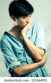 Fashion pose by a young male model, fashion tone
