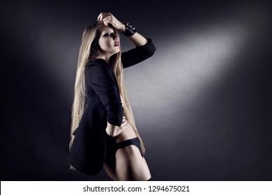 Fashion pretty girl posing in the studio