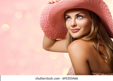 Fashion Pretty Young Woman in Peach Hat and Blond Hair Looks in Profile, Blurred Pink  Background with highlights in beige shades - Image