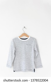 Fashion pullover (sweater) for the baby-boy hanging on shoulders isolate on white background for spring and summer wardrobe/ Baby clothes