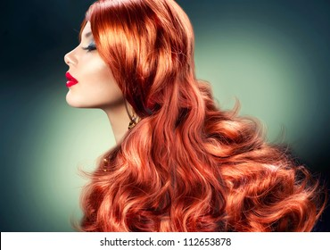 Fashion Red Haired Girl Portrait. Healthy Long Red Hair
